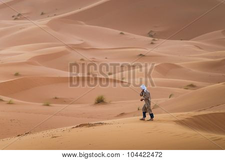A Touareg Walking In The Desert