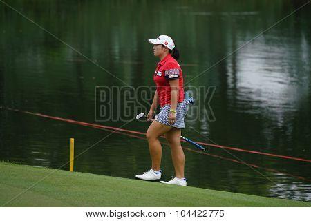 KUALA LUMPUR, MALAYSIA - OCTOBER 09, 2015: South Korea's Ha Na Jang walks to the 18th hole green at the KL Golf & Country Club at the 2015 Sime Darby LPGA Malaysia golf tournament.