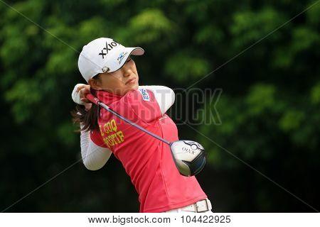 KUALA LUMPUR, MALAYSIA - OCTOBER 10, 2015: Japan's Sakura Yokomine tees off at the sixth hole of the KL Golf & Country Club on Round 3 day at the 2015 Sime Darby LPGA Malaysia golf tournament.