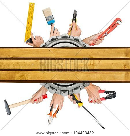 Humans hands holding different tools