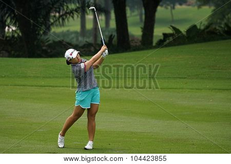 KUALA LUMPUR, MALAYSIA - OCTOBER 10, 2015: South Korea's Ha Na Jang plays on the fairway of the ninth hole of the KL Golf & Country Club during the 2015 Sime Darby LPGA Malaysia golf tournament.