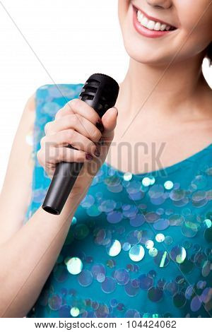 Smiling Young Woman Holding Microphone, Close Up