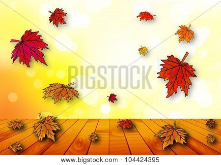 Autumn Leaves Falling On A Wooden Table