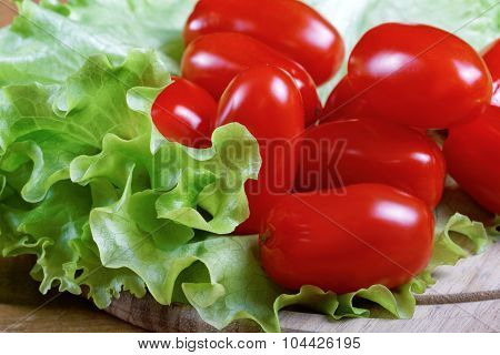 Small Tomatoes And Salad Leaves Close Up