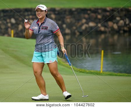 KUALA LUMPUR, MALAYSIA - OCTOBER 10, 2015: South Korea's Ha Na Jang reacts after her putt at the 18th hole of the KL Golf & Country Club during the 2015 Sime Darby LPGA Malaysia golf tournament.