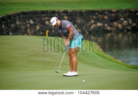 KUALA LUMPUR, MALAYSIA - OCTOBER 10, 2015: South Korea's Ha Na Jang putts at the 18th hole of the KL Golf & Country Club during the 2015 Sime Darby LPGA Malaysia golf tournament.