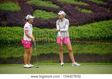 KUALA LUMPUR, MALAYSIA - OCTOBER 10, 2015: LPGA golfers Lydia Ko (left) and Jessica Korda chats after finishing play at the KL Golf & Country Club at the 2015 Sime Darby LPGA Malaysia golf tournament.