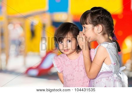 Child whispering.