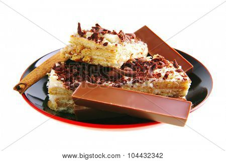 chocolate bars and cake with cinnamon on saucer