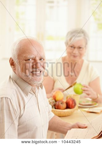 Portrait Of Older Man At Kitchen Table