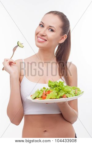 Cheerful fit girl is dieting with healthy food