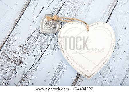White Heart With Text Love On Light Blue Wooden Background