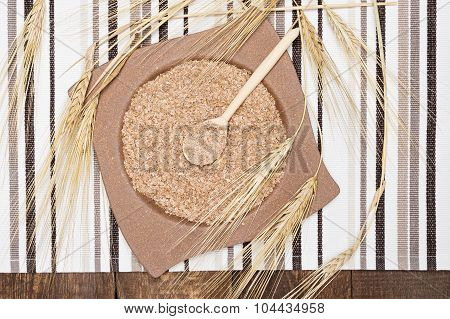 Wheat Bran In Bamboo Plate And Wooden Spoon With Wheat Ears