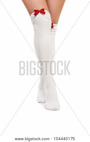 Female Legs In White Stockings With Red Bow Ties