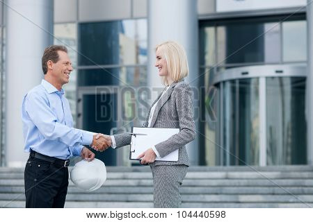 Professional two engineers are greeting each other