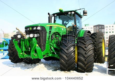 UFA, RUSSIA - MARCH 14: Large modern John Deere 8430 four wheel drive tractor with double wheels exhibited at the annual motor show