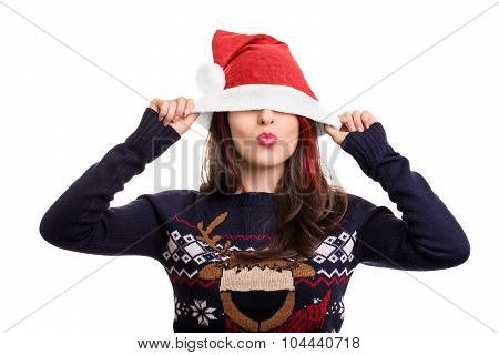 Portrait Of A Girl Putting On A Santa's Hat Over Her Face