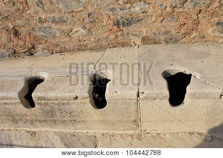 Public toilet in Ephesus antique ruins of the ancient city in Selcuk, Turkey