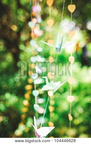 Origami Crane, Paper Birds On Bokeh Background. Shallow Deep Of Field.