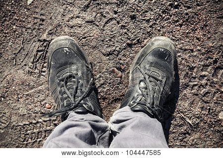 Male Feet In Black Shoes Standing On Road Mud