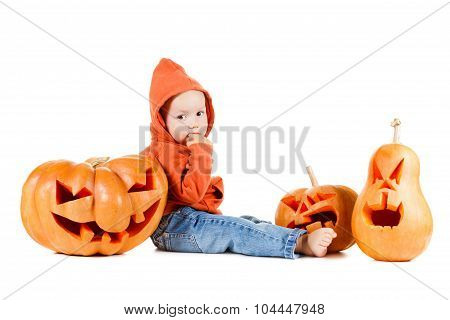 Baby And Halloveen Pumpkins With A Grimace On White Background