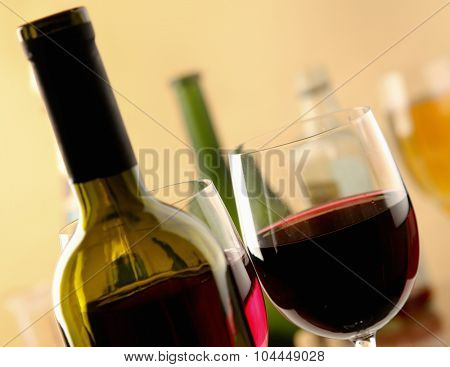 glass of red wine and the wine bottle.