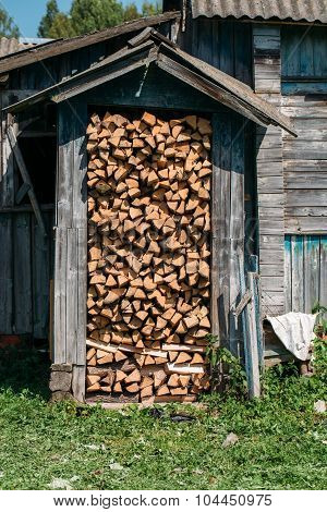 Shed filled with firewood.