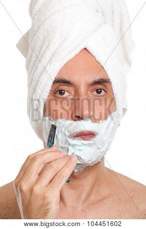 Handsome man shaving