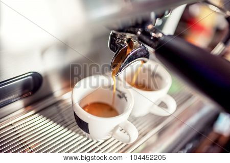 Espresso Machine Pouring Coffee Into Cups At Restaurant. Coffee Automatic Machine Making Coffee