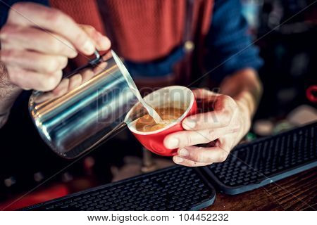 Barista Creating Latte Art On Long Coffee With Milk. Latte Art In Coffee Mug. Barman Pouring Coffee