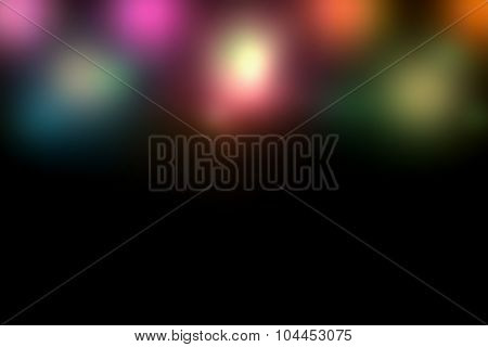 Abstract color lights blur background with black copy space.