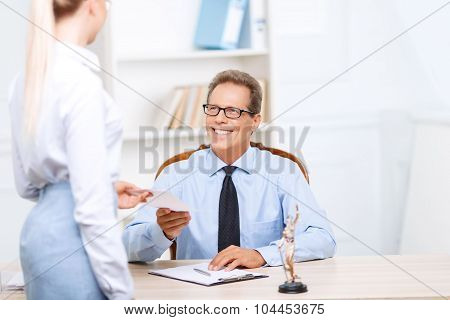 Professional lawyer giving papers to his assistant