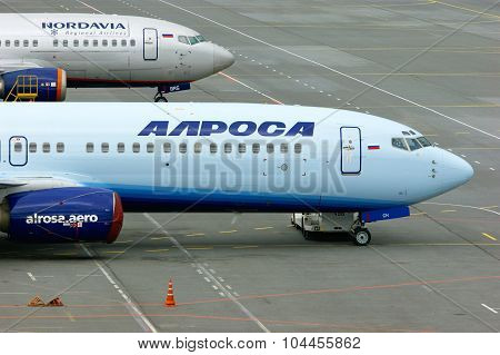 Alrosa And Nordavia Airlines Boeing 737-800 And 737-53C Aircrafts At The Parking In Pulkovo Internat