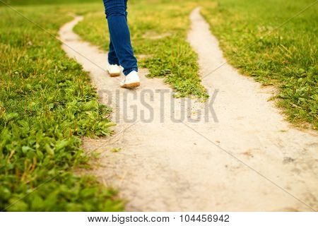 Fork Of Footpath And Feet Of Going Person