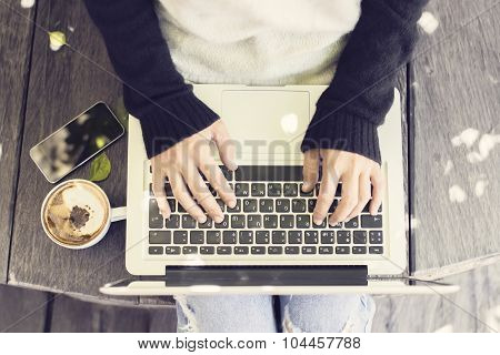 Girl Typing A Message In Laptop With Cappuccino And Smartphone