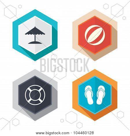 Beach holidays icons. Umbrella and sandals.