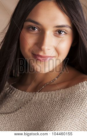 young pretty tanned girl close up portrait smiling confident