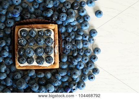 Gourmet fresh blueberry tart on table