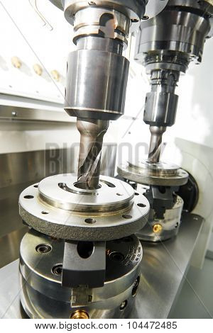 Metalwork industry. Twin milling machine tool with two mills in spindel ready to process metal detail at industrial manufacture factory