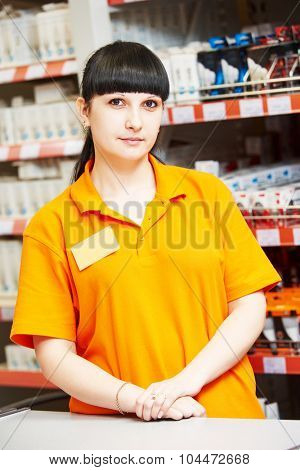 Positive female seller or shop assistant portrait  in hardware supermarket store