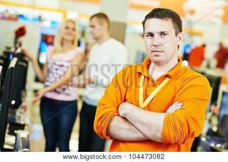 portrait shop assistants in supermarket store