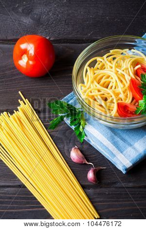 Fresh Pasta with tomatoes and parsley. Italian food
