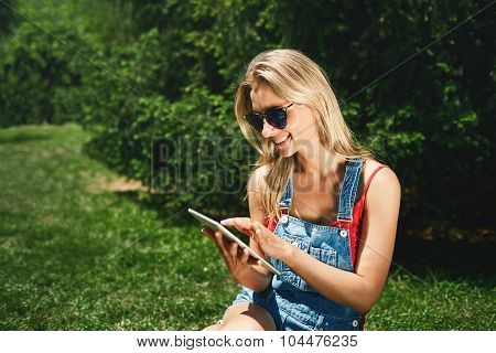 Portrait Of Happy Young Blonde Woman College Student Use Tablet