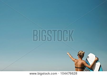 Blonde Girl Dressed In Swimsuit Standing On The Ocean Ready To Surfing, Female Surfer Holding Surfbo