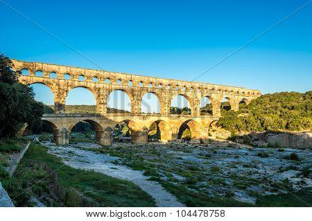 Morning View At Ancient Aqueduct Pont Du Gard