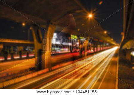 Abstract Blur Of Night Road Under The Expressway With Thumb Up.