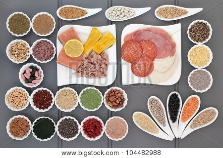 Health and super food with fish and meat, supplement powders, vitamin pills, pulses, nuts, vegetables, fruit, cereals and grains.