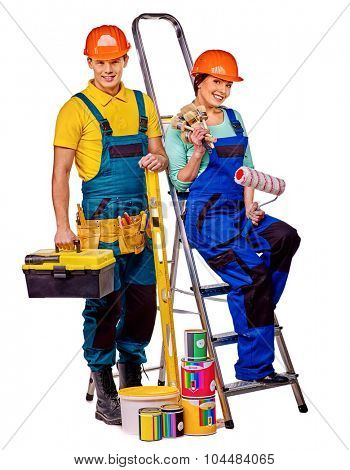Couple builder  in orange helmet with construction tools. Isolated.