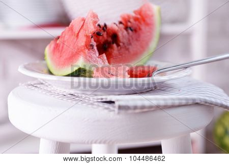 Watermelon on chair in the room