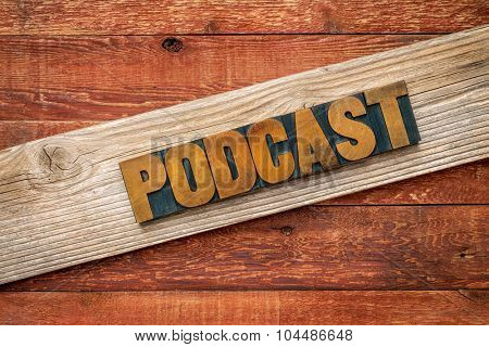 podcast rustic sign - letterpress wood type over grained cedar plank against red barn wood